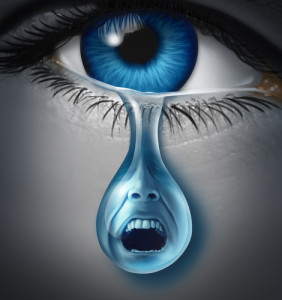 Distress and suffering with a human eye crying a single tear drop with a screaming facial expression of anguish and pain due to grief or emotional loss or business burnout.