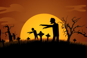 Silhouette Of Creepy Zombie Rising At Spooky Graveyard Against Moonlight