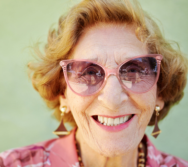 portrait of happy senior caucasian woman looking at camera and smiling. Horizontal shape, copy space